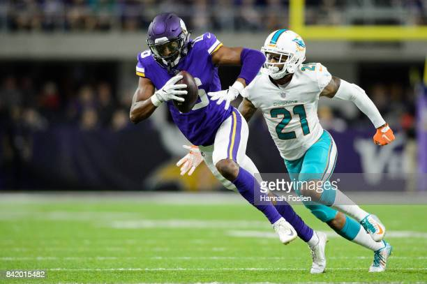 Jordan Lucas of the Miami Dolphins runs after Cayleb Jones of the Minnesota Vikings in the preseason game on August 31 2017 at US Bank Stadium in...