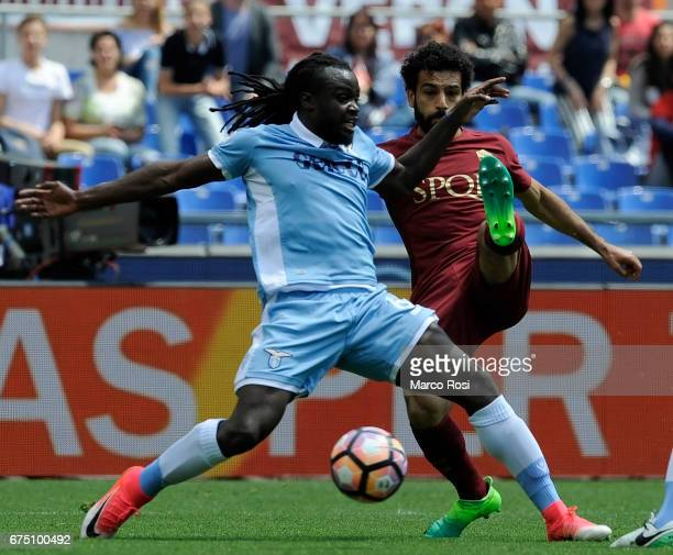 Jordan Lukaka of SS Lazio compete for the ball with Mohamed Salah of AS Roma during the Serie A match between AS Roma and SS Lazio at Stadio Olimpico...
