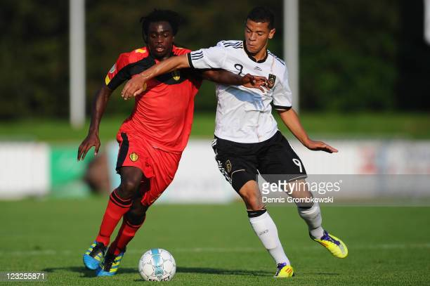Jordan Lukaku of Belgium is challenged by Shawn Parker of Germany during the U19 International friendly match between Belgium and Germany at Stade...
