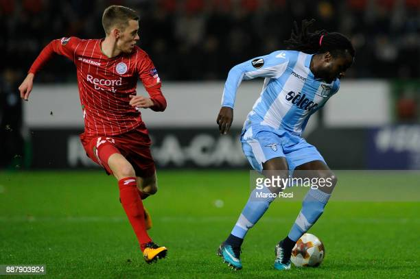 Jordan Lukaku of SS Lazio compete for the ball with Michael Heylen of SV Zulte Waregem during the UEFA Europa League group K match between SV Zulte...