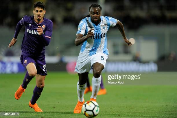 Jordan Lukaku of SS Lazio competes for the ball with Gil Dias of ACF Fiorentinaduring the Serie A match between ACF Fiorentina and SS Lazio at Stadio...