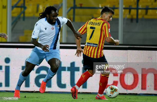 Jordan Lukaku of SS Lazio competes for the ball with Giulio Donati during the Serie A match between US Lecce and SS Lazio at Stadio Via del Mare on...
