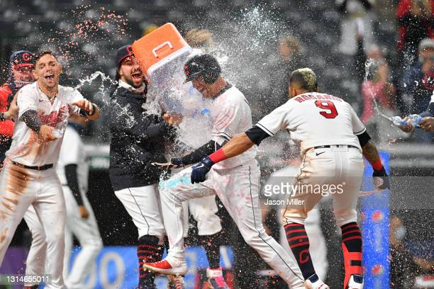Jordan Luplow of the Cleveland Indians celebrates with his teammates after hitting a walk-off two run home run during the tenth inning against the...