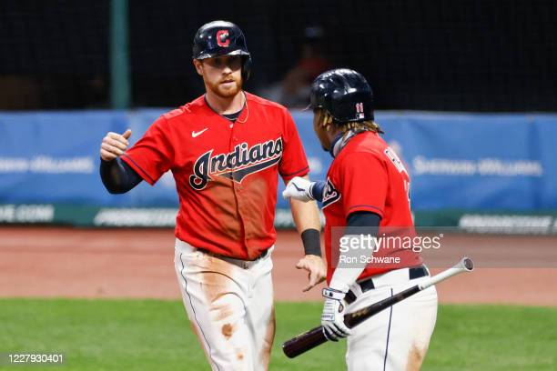 Jordan Luplow of the Cleveland Indians celebrates with Jose Ramirez after scoring on a single by Cesar Hernandez against relief pitcher Michael...