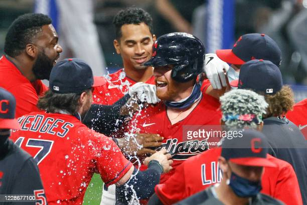 Jordan Luplow of the Cleveland Indians, center, celebrates with teammates after hitting a game winning solo home run off Gio González of the Chicago...