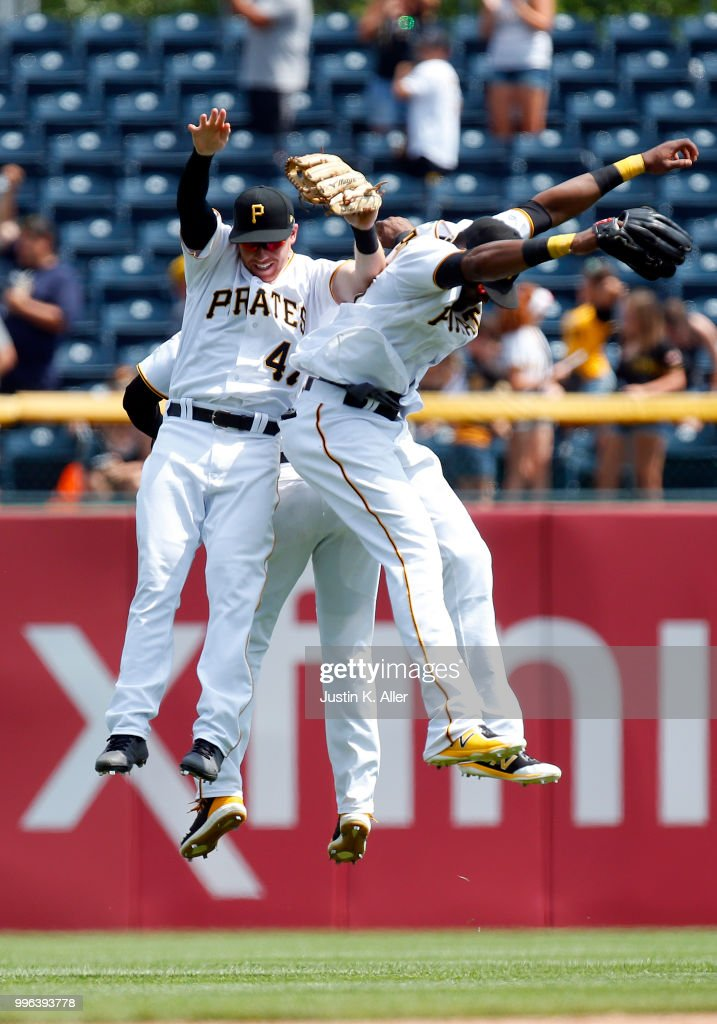 Jordan Luplow #47 of the Pittsburgh Pirates, Gregory Polanco #25 of the Pittsburgh Pirates and Starling Marte #6 of the Pittsburgh Pirates celebrate after defeating the Washington Nationals 2-0 at PNC Park on July 11, 2018 in Pittsburgh, Pennsylvania.