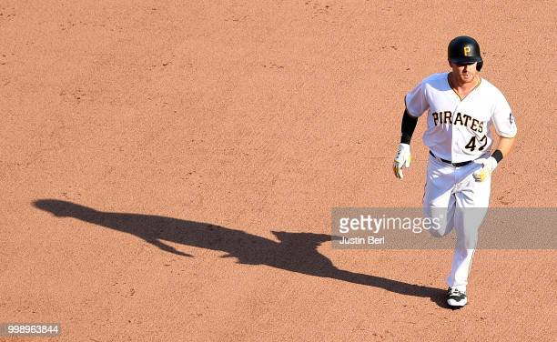 Jordan Luplow of the Pittsburgh Pirates rounds the bases after hitting a solo home run in the seventh inning during the game against the Milwaukee...