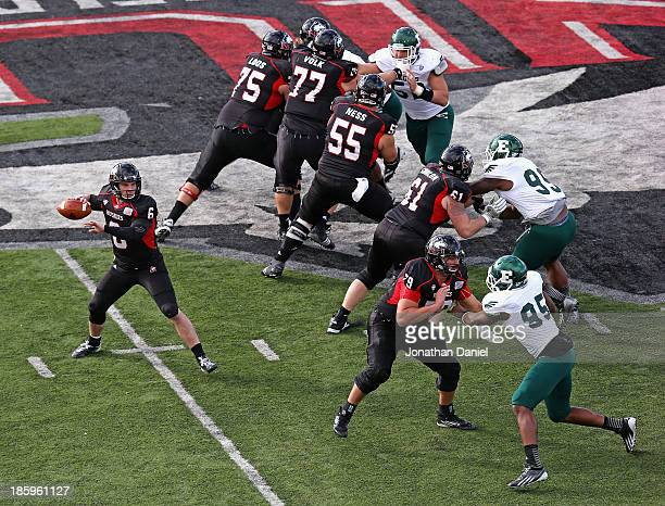 Jordan Lynch of the Northern Illinois Huskies drops back to pass under the protection of his offensive line against the Eastern Michigan Eagles at...