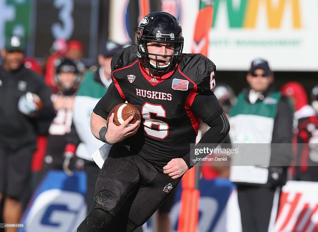 Jordan Lynch #6 of the Northern Illinois Huskies runs for a touchdown against the Eastern Michigan Eagles at Brigham Field on October 26, 2013 in DeKalb, Illinois. Northern Illinois defeated Eastern Michigan 59-20.