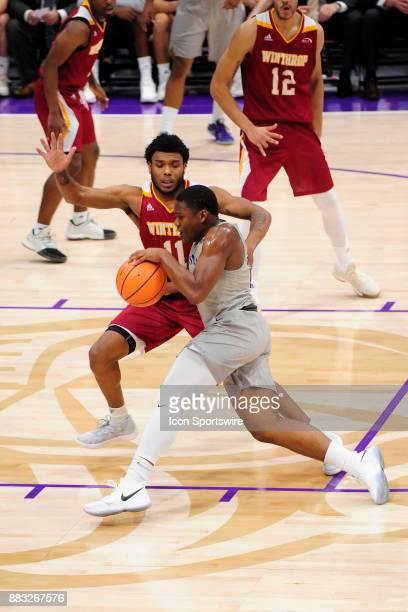 Jordan Lyons guard Furman University Paladins works past defender =wu11= November 29 at Timmons Arena in Greenville South Carolina