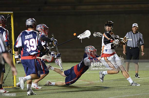 Jordan Macintosh of the Rochester Rattlers shoots behind his back against the Boston Cannons at Harvard Stadium on August 10, 2013 in Cambridge,...
