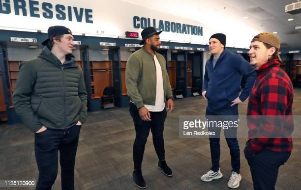 Jordan Mailata of the Philadelphia Eagles gives a tour in the locker room of the Eagles to Travis Sanheim Travis Konecny and James van Riemsdyk in...