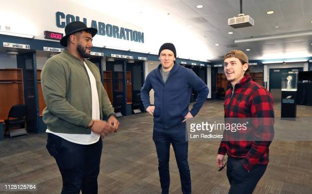 Jordan Mailata of the Philadelphia Eagles gives a tour in the locker room of the Eagles to James van Riemsdyk and Travis Konecny in preparation for...