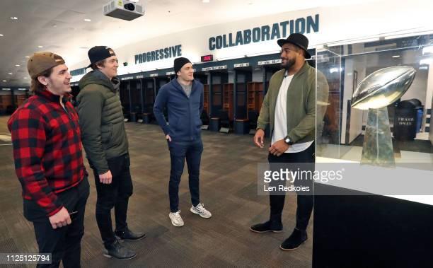 Jordan Mailata of the Philadelphia Eagles gives a tour in the locker room of the Eagles to Travis Konecny Travis Sanheim and James van Riemsdyk in...
