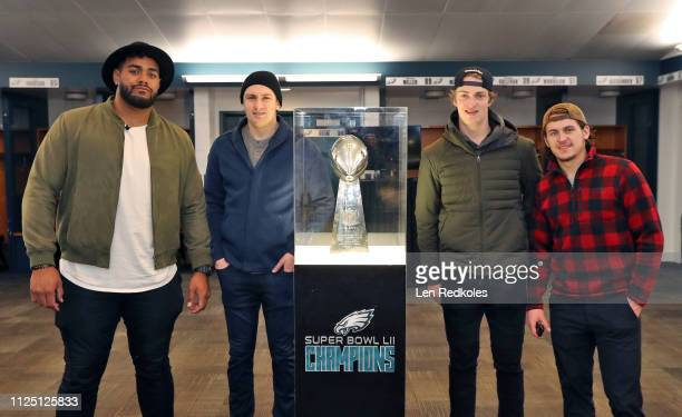 Jordan Mailata of the Philadelphia Eagles poses for a photo next to the Lombardi Trophy in the locker room of the Eagles with James van Riemsdyk...