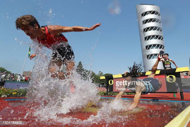 Jordan Mann falls into the water as he and Jordan Cross compete in the first round of Men's 3000 Meters Steeplechase during day four of the 2020 U.S....