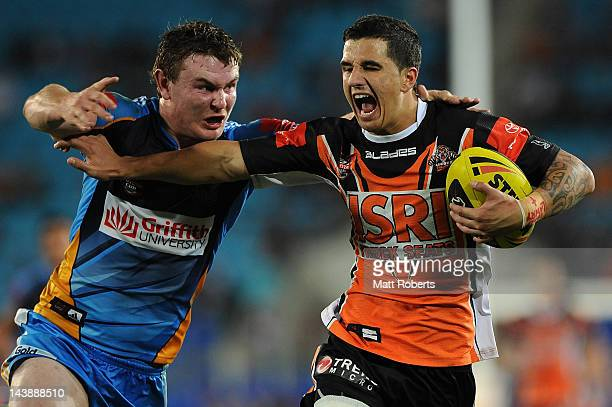 Jordan MarshallKing of the Tigers fends off Tom Dawney of the Titans during the round nine Toyota Cup match between the Gold Coast Titans and the...