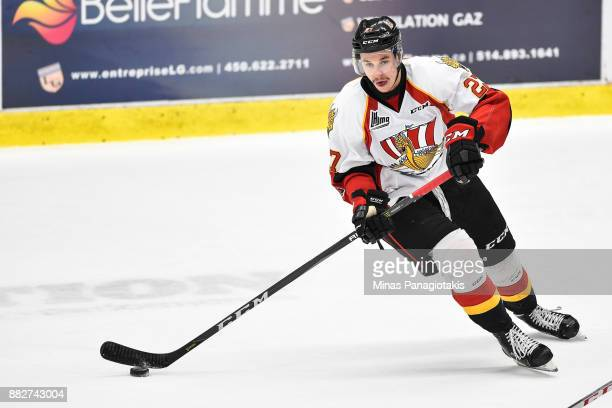 Jordan Martel of the BaieComeau Drakkar skates the puck against the BlainvilleBoisbriand Armada during the QMJHL game at Centre d'Excellence Sports...