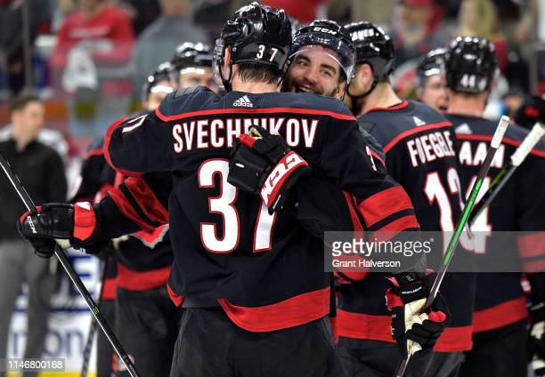 Jordan Martinook and Andrei Svechnikov of the Carolina Hurricanes celebrate after a win against the New York Islanders in Game Four of the Eastern...