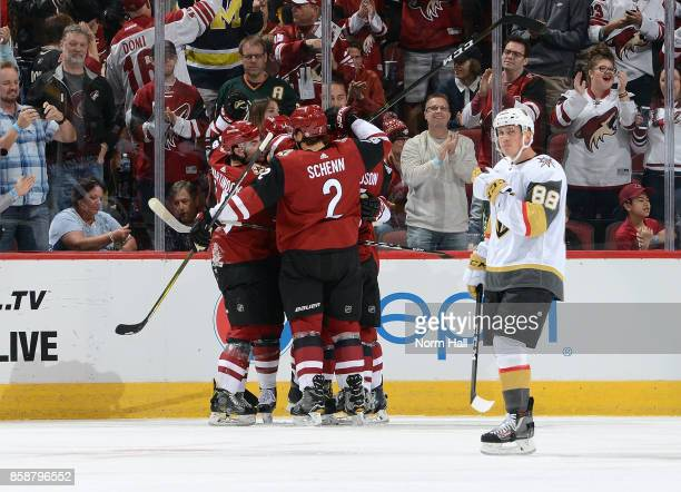 Jordan Martinook and Luke Schenn of the Arizona Coyotes celebrate with teammates after a goal by Tobias Rieder of the Coyotes as Nate Schmidt of the...