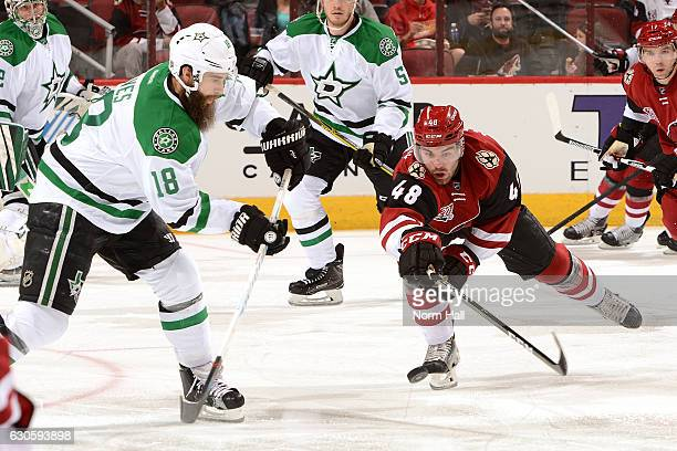 Jordan Martinook of the Arizona Coyotes attempts to block a pass by Patrick Eaves of the Dallas Stars during the first period at Gila River Arena on...