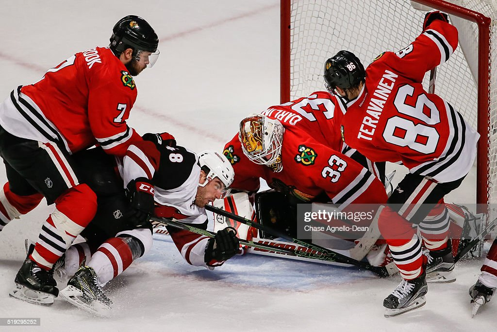 Jordan Martinook #48 of the Arizona Coyotes attempts to get the puck past goalie Scott Darling #33 of the Chicago Blackhawks in the third period of the NHL game at the United Center on April 5, 2016 in Chicago, Illinois. The Chicago Blackhawks defeated the Arizona Coyotes 6 to 2.