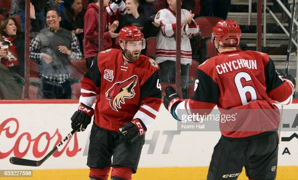 Jordan Martinook of the Arizona Coyotes celebrates with teammate Jakob Chychrun after scoring a first period goal against the Los Angeles Kings at...
