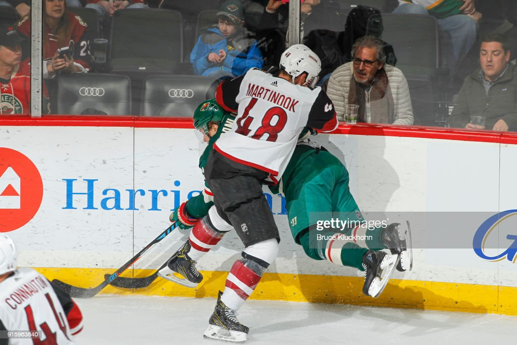Jordan Martinook #48 of the Arizona Coyotes checks Mikael Granlund #64 of the Minnesota Wild during the game at the Xcel Energy Center on February 8, 2018 in St. Paul, Minnesota.