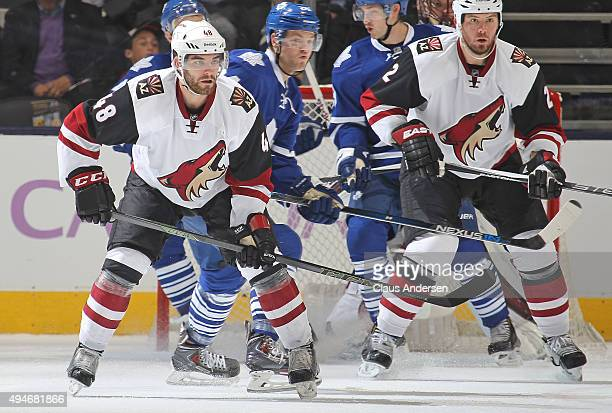 Jordan Martinook of the Arizona Coyotes defends against the Toronto Maple Leafs during an NHL game at the Air Canada Centre on October 26 2015 in...