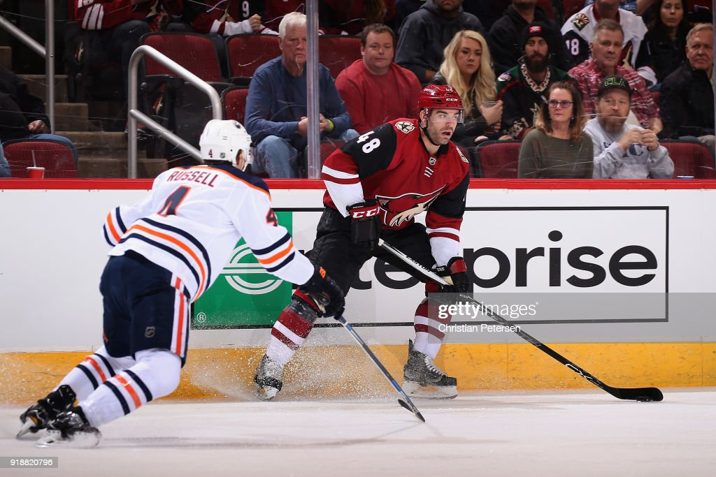 Jordan Martinook #48 of the Arizona Coyotes looks to pass ahead of Kris Russell #4 of the Edmonton Oilers during the first period of the NHL game at Gila River Arena on January 12, 2018 in Glendale, Arizona.