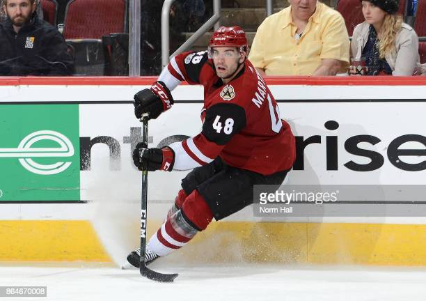 Jordan Martinook of the Arizona Coyotes looks to pass the puck against the Dallas Stars at Gila River Arena on October 19 2017 in Glendale Arizona