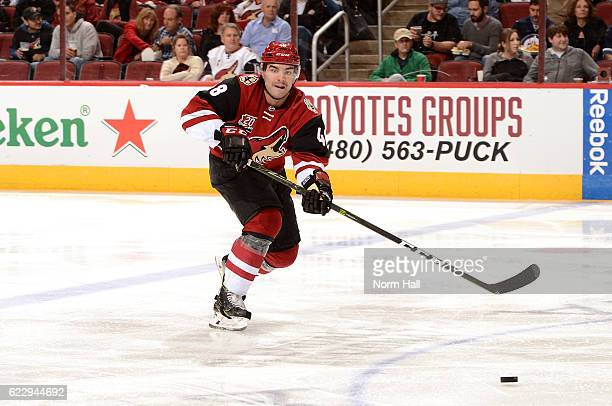 Jordan Martinook of the Arizona Coyotes passes the puck against the Winnipeg Jets at Gila River Arena on November 10 2016 in Glendale Arizona
