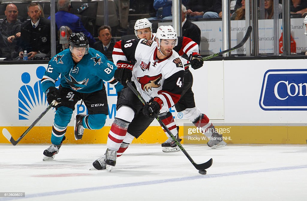 Jordan Martinook #48 of the Arizona Coyotes skates with the puck against Nikolay Goldobin #82 of the San Jose Sharks at SAP Center on September 30, 2016 in San Jose, California.