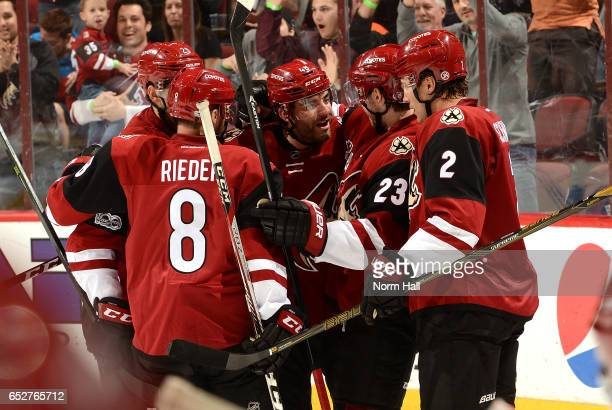Jordan Martinook Oliver EkmanLarsson Luke Schenn and Tobias Rieder of the Arizona Coyotes celebrate a goal against the Ottawa Senators at Gila River...