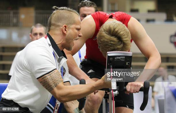 Jordan Marwin encourages Casey Mittelstadt on the Wingate Cycle during the NHL Combine at HarborCenter on June 3 2017 in Buffalo New York