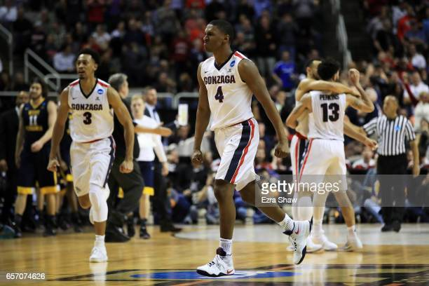 Jordan Mathews and Johnathan Williams of the Gonzaga Bulldogs celebrate their 61 to 58 win over the West Virginia Mountaineers during the 2017 NCAA...
