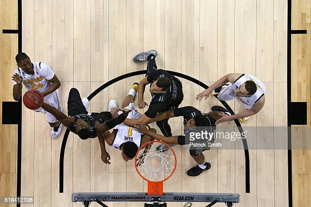 Jordan Mathews of the California Golden Bears shoots in front of multiple Hawaii Warriors defenders during the first round of the NCAA Men's...