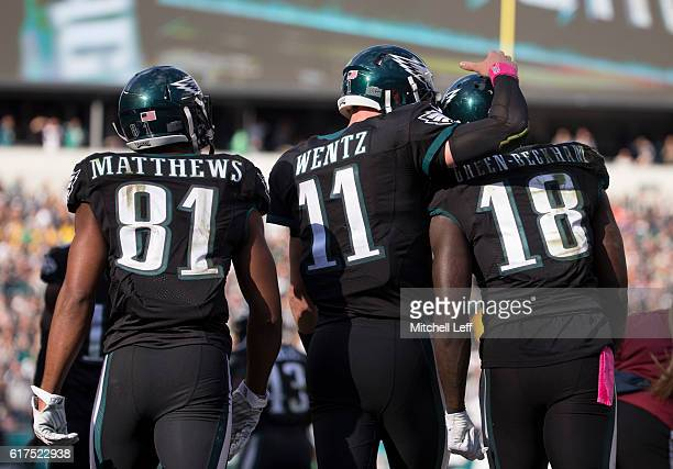 Jordan Matthews Carson Wentz and Dorial GreenBeckham of the Philadelphia Eagles celebrate after a touchdown in the third quarter against the...