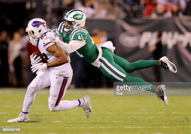 Jordan Matthews of the Buffalo Bills is tackled by Buster Skrine of the New York Jets during the first half of the game at MetLife Stadium on...
