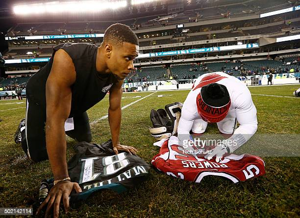 Jordan Matthews of the Philadelphia Eagles and Jerraud Powers of the Arizona Cardinals sign each others jersey before exchanging them after the...