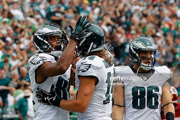 Jordan Matthews of the Philadelphia Eagles celebrates his 11yard touchdown with teammate Riley Cooper in the second quarter against the Washington...