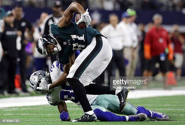Jordan Matthews of the Philadelphia Eagles is tackled by Brandon Carr of the Dallas Cowboys in the fourth quarter at ATT Stadium on October 30 2016...
