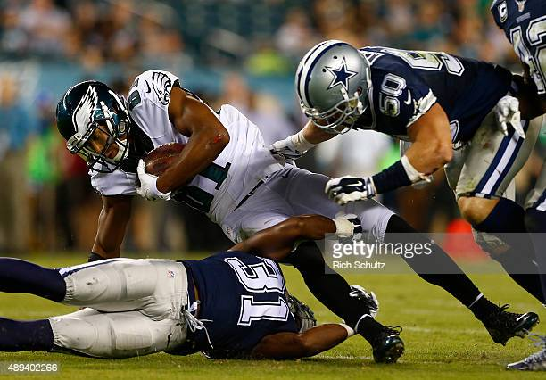 Jordan Matthews of the Philadelphia Eagles is tackled by Byron Jones and Sean Lee of the Dallas Cowboys during the third quarter during a football...