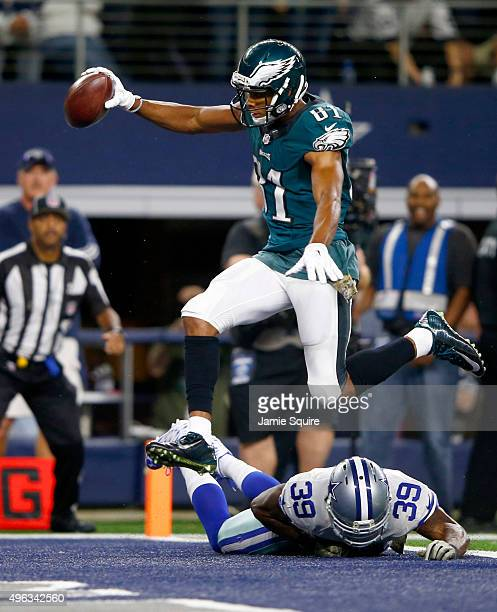 Jordan Matthews of the Philadelphia Eagles leaps over Brandon Carr of the Dallas Cowboys to score the winning touchdown in overtime at ATT Stadium on...