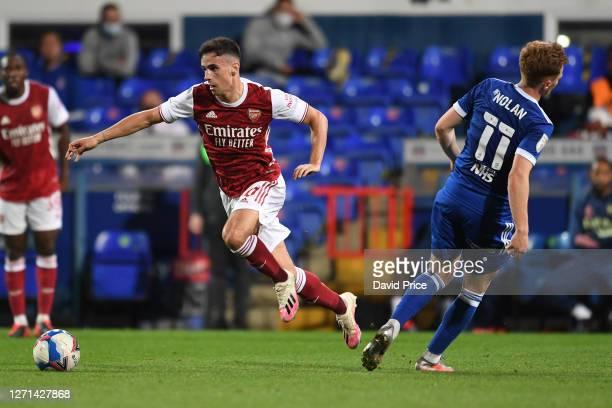 Jordan McEneff of Arsenal skips away from Jon Nolan of Ipswich during the Leasingcom Cup match between Ipswich Town and Arsenal U21 at Portman Road...