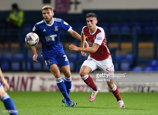 Jordan McEneff of Arsenal takes on Aaron Drinan of Ipswich during the Leasingcom Cup match between Ipswich Town and Arsenal U21 at Portman Road on...
