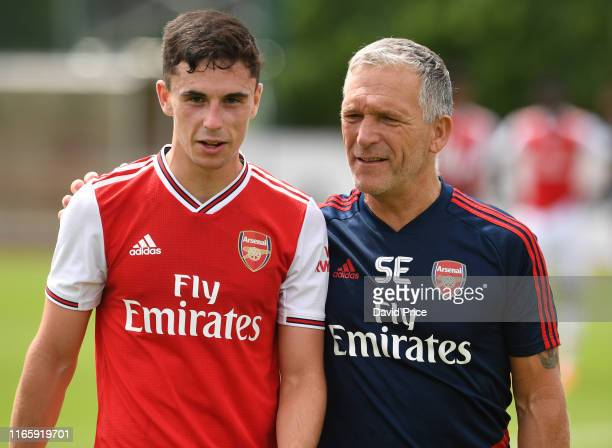 Jordan McEneff of Arsenal with Massuer Steve East after the match between Arsenal U23 and Watford XI at London Colney on August 03 2019 in St Albans...