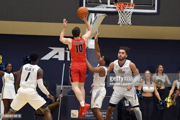 Jordan McKenzie of the Stony Brook Seawolves takes a shot during a college basketball game against the George Washington Colonials at the Smith...