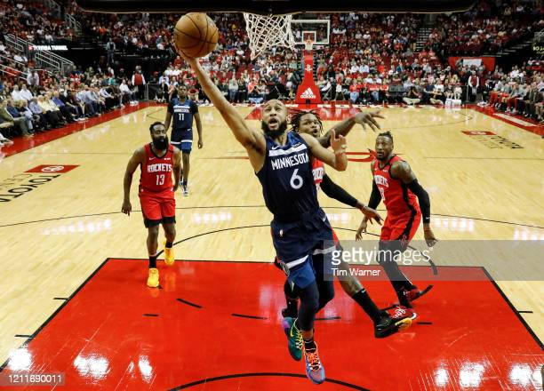 Jordan McLaughlin of the Minnesota Timberwolves drives to the basket while defended by Ben McLemore of the Houston Rockets in the first half at...