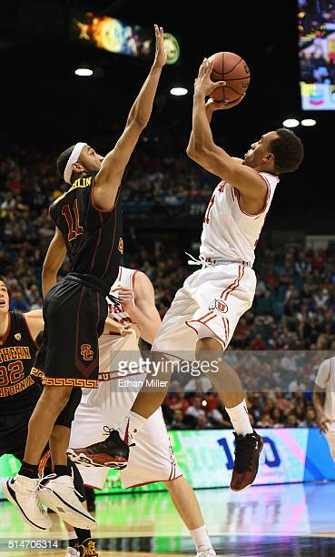 Jordan McLaughlin of the USC Trojans blocks a shot by Brandon Taylor of the Utah Utes during a quarterfinal game of the Pac12 Basketball Tournament...